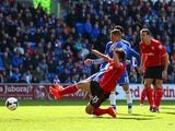 Fernando Torres of Chelsea scores their second goal during the Barclays Premier League match between Cardiff City and Chelsea at Cardiff City Stadium on May 11, 2014