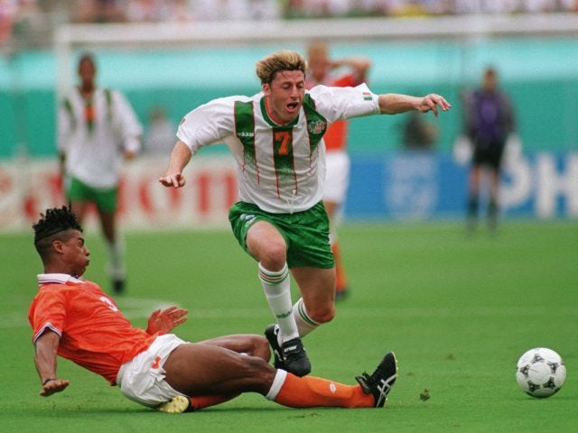 Former Netherlands midfielder Frank Rijkaard slide tackles Andy Townsend on July 04, 1994.