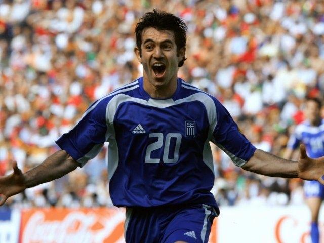 Midfielder Giorgos Karagounis celebrates scoring for Greece against Portugal on June 12, 2004.