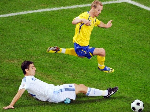 Greece defender Giourkas Seitaridis performs a slide challenge against Sweden on June 10, 2008.