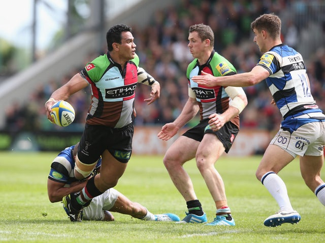 Maurie Fa'asavalu of Harlequins off loads the ball during the Aviva Premiership match between Harlequins and Bath at the Twickenham Stoop on May 10, 2014