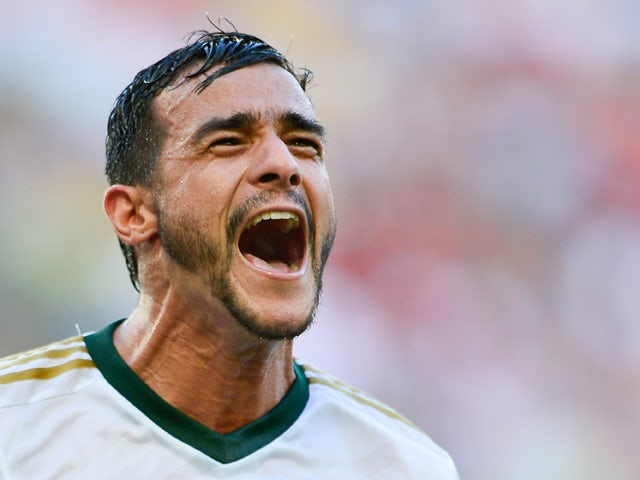 Henrique of Palmeiras celebrates a scored goal against Flamengo during a match between Flamengo and Palmeiras as part of Brasileirao Series A 2014 at Maracana Stadium on May 04, 2014