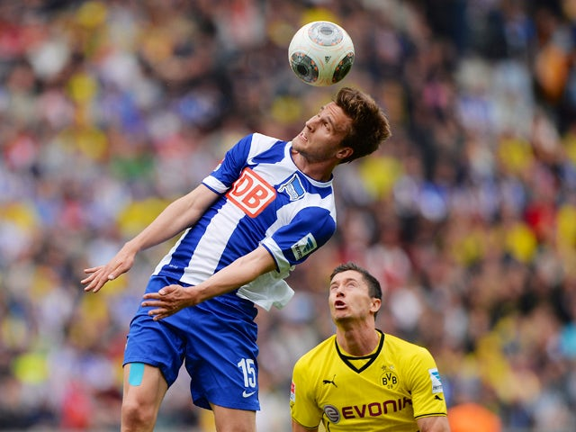 Hertha's defender Sebastian Langkamp and Dortmund's Polish striker Robert Lewandowski vie for the ball during the German first division Bundesliga football match Hertha BSC Berlin vs Borussia Dortmund in Berlin on May 10, 2014