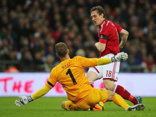 England goalkeeper Joe Hart makes a save against Denmark on March 05, 2014.