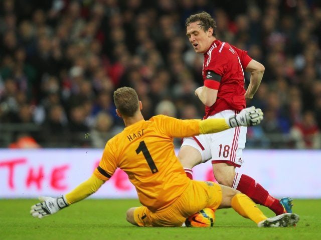 England goalkeeper Joe Hart makes a save against Denmark on March 05, 2014.