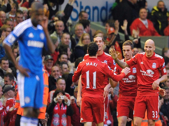 Liverpool's English midfielder Jonjo Shelvey (2R) celebrates after scoring the second goal during the English Premier League football match between Liverpool and Chelsea on May 8, 2012