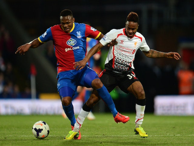 Kagisho Dikgacoi of Crystal Palace and Raheem Sterling of Liverpool battle for the all during the Barclays Premier League match on May 5, 2014