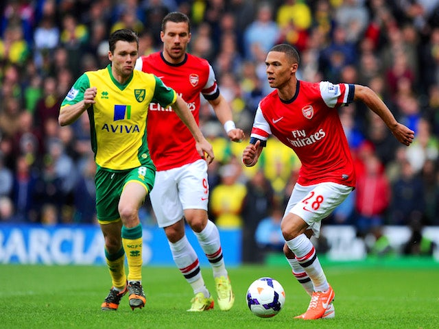 Jonathan Howson of Norwich City closes down Kieran Gibbs of Arsenal during the Barclays Premier League match between Norwich City and Arsenal at Carrow Road on May 11, 2014