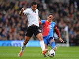 Kieran Richardson of Fulham is challenged by Thomas Ince of Crystal Palace during the Barclays Premier League match between Fulham and Crystal Palace at Craven Cottage on May 11, 2014