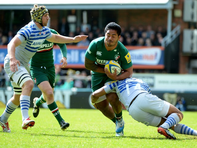 Manusamoa Tuilagi of Leicester Tigers is tackled by Michael Tagicakbau of Saracens during the Aviva Premiership match between Leicester Tigers and Saracens at Welford Road on May 10, 2014