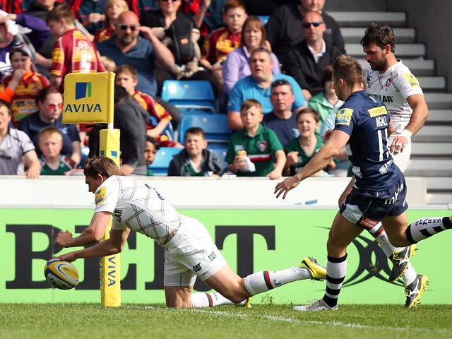 Toby Flood of Leicester Tigers goes over for his try during the Aviva Premiership match between Sale Sharks and Leicester Tigers at AJ Bell Stadium on May 3, 2014