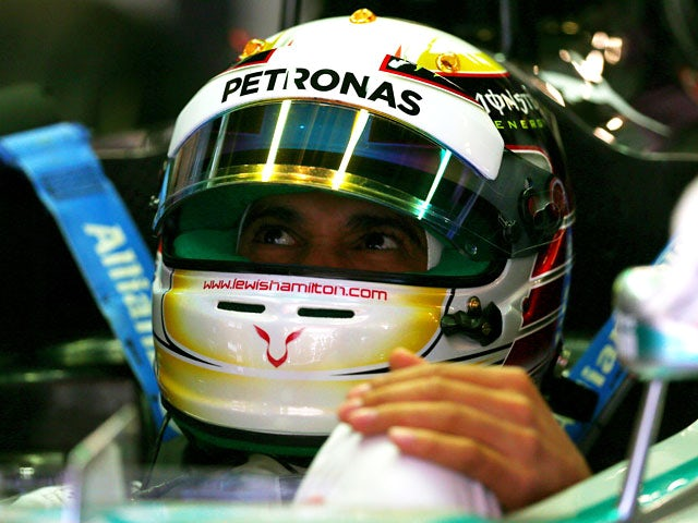 Lewis Hamilton of Mercedes sits in his car during a practise session of the F1 Spanish Grand Prix on May 9, 2014