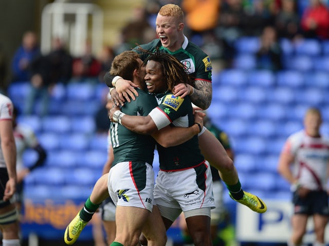 Andrew Fenby of London Irish celebrates his try with Marland Yarde and Tom Homer during the Aviva Premiership match between London Irish and Sale Sharks at the Madejski Stadium on May 10, 2014