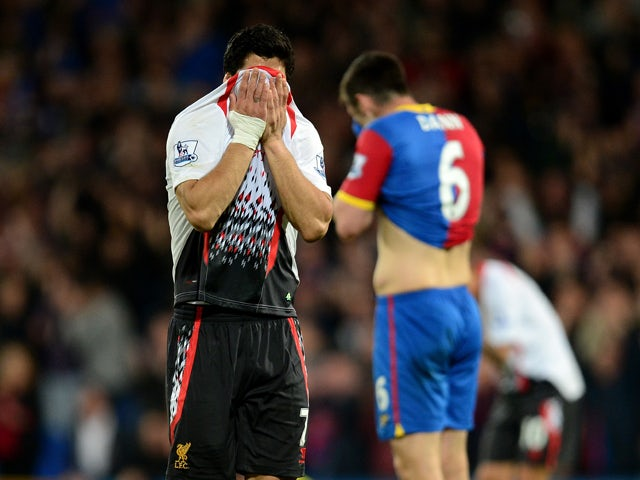 A dejected Luis Suarez of Liverpool reacts following his team's 3-3 draw during the Barclays Premier League match between Crystal Palace and Liverpool at Selhurst Park on May 5, 2014