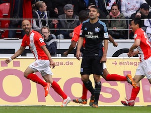 Mainz' Colombian midfielder Elkin Soto celebrates after scoring the 1-0 during the German first division Bundesliga football match FSV Mainz 05 vs Hamburger SV in Mainz, western Germany, on May 10, 2014