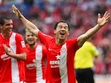 Mainz' Japanese striker Shinji Okazaki celebrates after scoring the 3-1 during the German first division Bundesliga football match FSV Mainz 05 vs Hamburger SV in Mainz, western Germany, on May 10, 2014