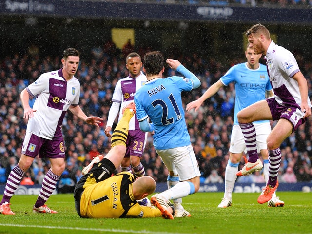 Goalkeeper Brad Guzan of Aston Villa makes a save from David Silva of Manchester City during the Barclays Premier League match between Manchester City and Aston Villa at Etihad Stadium on May 7, 2014