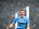 Manchester City's Bosnian striker Edin Dzeko celebrates scoring the opening goal during the English Premier League football match between Manchester City and Aston Villa at the Etihad Stadium in Manchester, Northwest England, on May 7, 2014