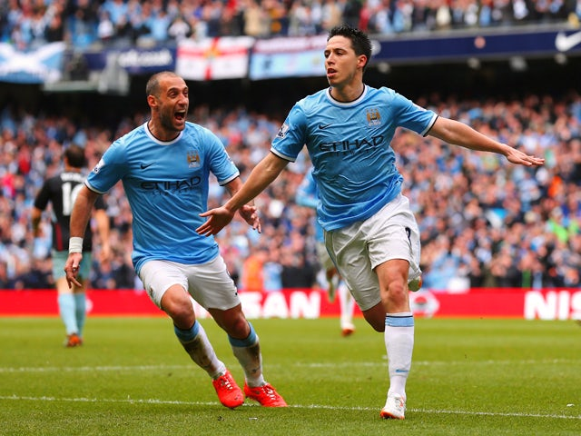 Samir Nasri of Manchester City celebrates scoring the first goal during the Barclays Premier League match between Manchester City and West Ham United at the Etihad Stadium on May 11, 2014