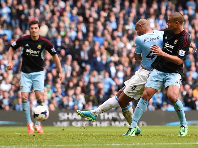 Vincent Kompany of Manchester City scores the second goal during the Barclays Premier League match between Manchester City and West Ham United at the Etihad Stadium on May 11, 2014