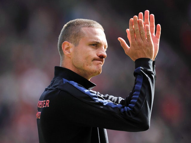 Manchester United's Serbian defender Nemanja Vidic thanks the fans after the English Premier League football match between Southampton and Manchester United at St Mary's stadium in in Southampton on May 11, 2014