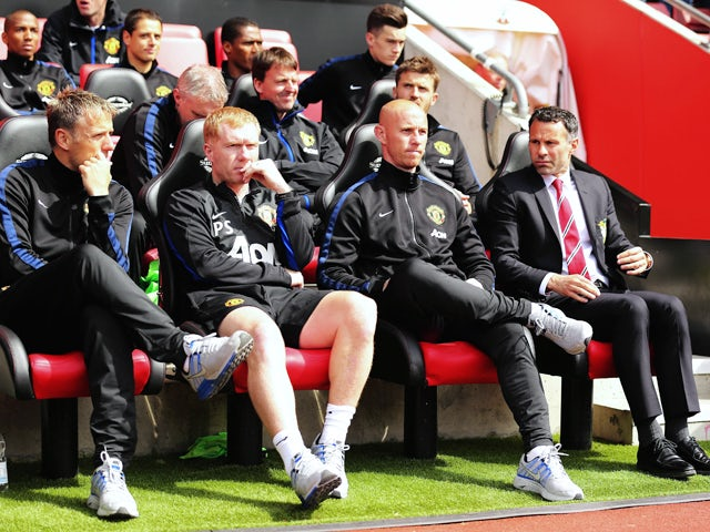 Manchester United interim manager Ryan Giggs looks on alongside assistants, Nicky Butt, Paul Scholes and Phil Neville before the Barclays Premier League match between Southampton and Manchester United at St Mary's Stadium on May 11, 2014