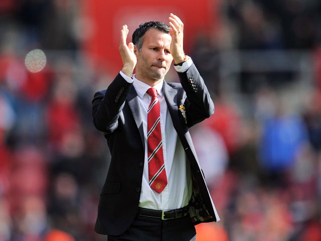 Manchester United's Interim manager Ryan Giggs thanks the fans after the English Premier League football match between Southampton and Manchester United at St Mary's stadium in in Southampton on May 11, 2014