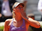 Maria Sharapova blows a kiss to the crowd after her three set victory against Na Li  in their quarter final Madrid Masters match on May 9, 2014