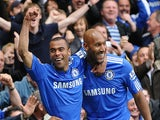 Nicolas Anelka (R) celebrates scoring the fourth goal with English defender Ashley Cole (L) during the English Premier League football match between Chelsea and Wigan Athletic on May 9, 2010