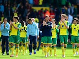 Norwich City players applaud the fans at the end of the match during the Barclays Premier League match between Norwich City and Arsenal at Carrow Road on May 11, 2014