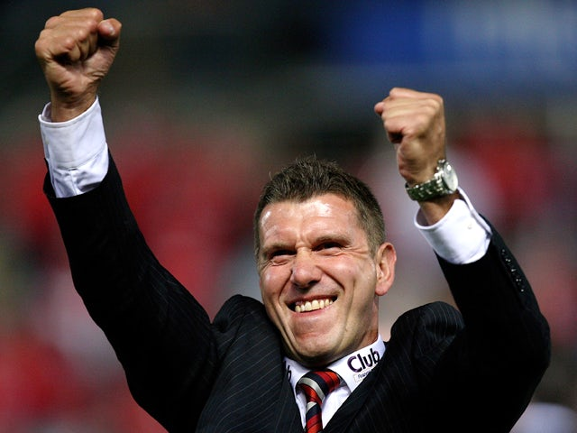 Phil Stubbins the assistant coach of United celebrates winning the A-League Preliminary Final match between Adelaide United and the Queensland Roar at Hindmarsh Stadium on February 21, 2009