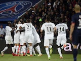 Rennes' players celebrate after scoring during the French L1 football match Paris Saint-Germain vs Rennes at the Parc Des Princes stadium in Paris on May 7, 2014