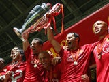 Manchester United teammates Rio Ferdinand and Ryan Giggs lift the Champions League trophy on May 21, 2008.