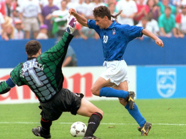 Italy striker Roberto Baggio rounds the goalkeeper on his way to scoring against Spain on July 09, 1994.