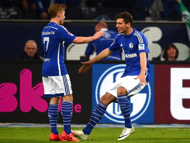 Schalke's midfielder Max Meyer and Schalke's midfielder Leon Goretzka celebrate after their team scored during the German first division Bundesliga football match FC Schalke 04 vs 1 FC Nuremberg in Gelsenkirchen, western Germany on May 10, 2014