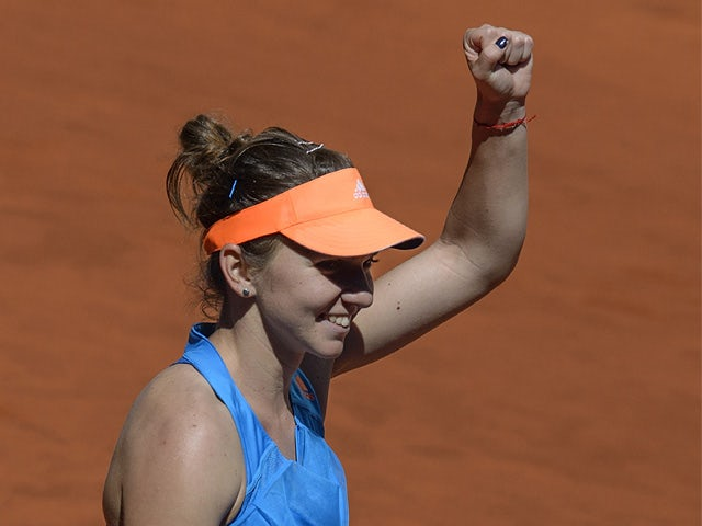 Simona Halep celebrates victory over Ana Ivanovic in their quarter final Madrid Masters match on May 9, 2014