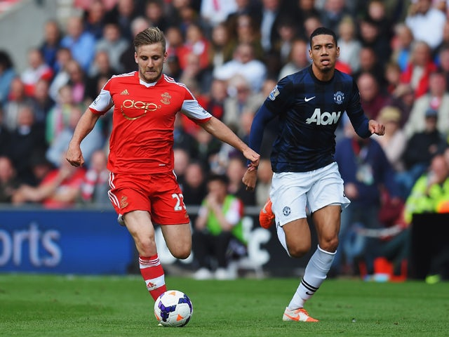 Luke Shaw of Southampton holds off Chris Smalling of Manchester United during the Barclays Premier League match between Southampton and Manchester United at St Mary's Stadium on May 11, 2014