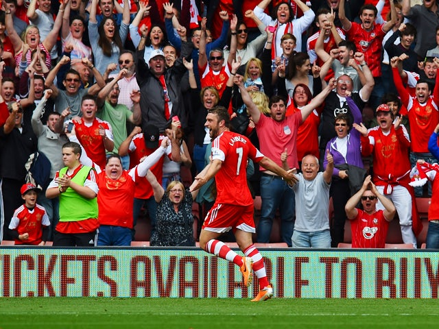 Rickie Lambert of Southampton celebrates after scoring during the Barclays Premier League match between Southampton and Manchester United at St Mary's Stadium on May 11, 2014