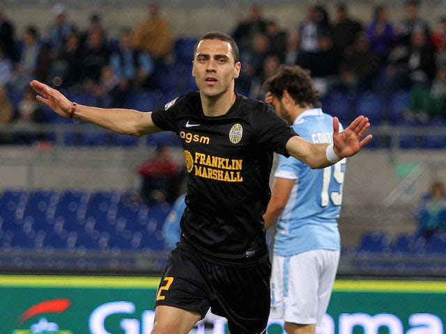 Souza Orestes Romulo of Hellas Verona celebrates after scoring his team's third goal during the Serie A match on May 5, 2014
