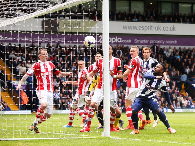 Stoke City repel a West Bromwich Albion attack during the Barclays Premier League match between West Bromwich Albion and Stoke City at The Hawthorns on May 11, 2014