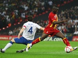Ghana's Sulley Muntari takes on England midfielder Gareth Barry on March 29, 2011.