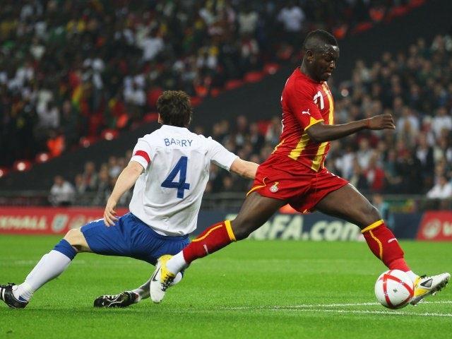 Ghana's Sulley Muntari takes on England midfielder Gareth Barry on March 29, 2011.