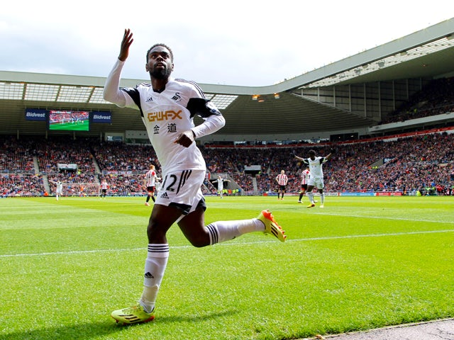 Swansea City's Nathan Dyer celebrates his opening goal during the Barclays Premier League match between Sunderland and Swansea City at Stadium of Light on May 11, 2014