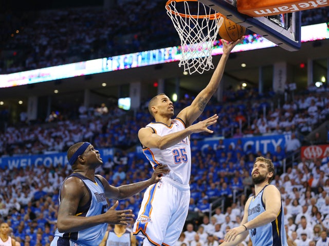 Thabo Sefolosha #25 of the Oklahoma City Thunder takes a shot against Zach Randolph #50 of the Memphis Grizzlies in Game Two of the Western Conference Quarterfinals during the 2014 NBA Playoffs at Chesapeake Energy Arena on April 21, 2014