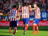 Atletico Madrid's Toby Alderweireld celebrates after scoring his team's first goal against Malaga during the La Liga match on May 11, 2014