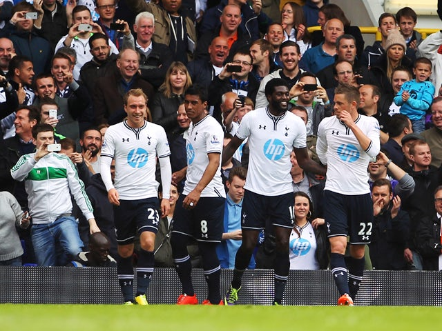 Emmanuel Adebayor of Tottenham Hotspur celebrates with team mates after scoring during the Barclays Premier League match between Tottenham Hotspur and Aston Villa at White Hart Lane on May 11, 2014