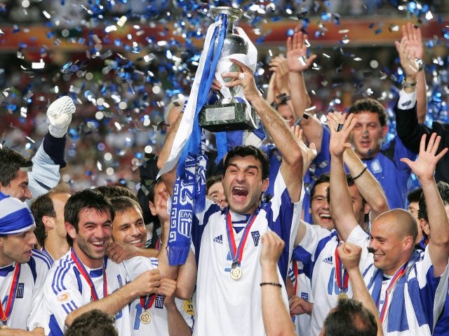Greece captain Traianos Dellas lifts the European Championships trophy on July 04, 2004.