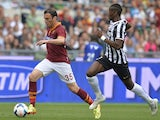 AS Roma's Greek defender Vasilis Torosidis (L) controls the ball near Juventus' French midfielder Paul Labile Pogba during their Italian Serie A football match on May 11, 2014