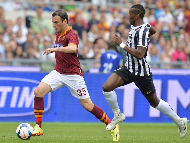 AS Roma's Greek defender Vasilis Torosidis (L) controls the ball near Juventus' French midfielder Paul Labile Pogba during their Italian Serie A football match on May 11, 2014