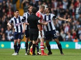 Gareth McAuley of West Bromwich Albion clashes with Ryan Shawcross of Stoke City as referee Lee Probert intervenes during the Barclays Premier League match between West Bromwich Albion and Stoke City at The Hawthorns on May 11, 2014